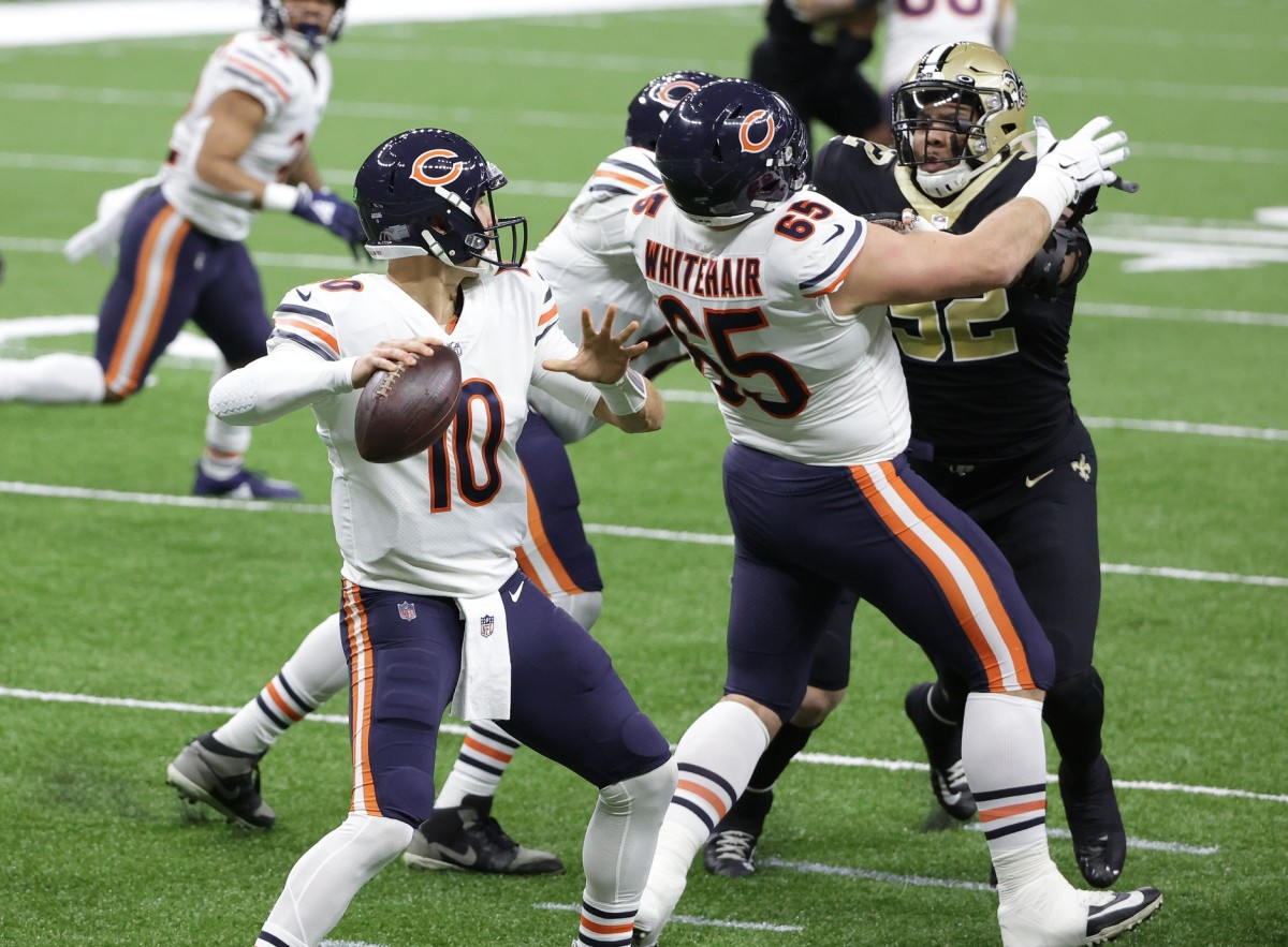 Jan 10, 2021; New Orleans, Louisiana, USA; Chicago quarterback Mitchell Trubisky (10) drops back to pass against New Orleans Saints defensive end Marcus Davenport (92) in the NFC Wild Card game. Mandatory Credit: Derick E. Hingle-USA TODAY