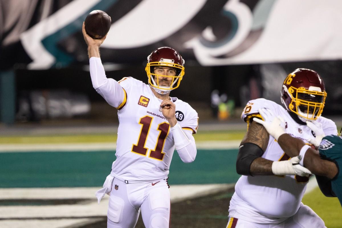 Jan 3, 2021; Philadelphia, Pennsylvania, USA; Washington quarterback Alex Smith (11) passes the ball against the Philadelphia Eagles. Mandatory Credit: Bill Streicher-USA TODAY Sports