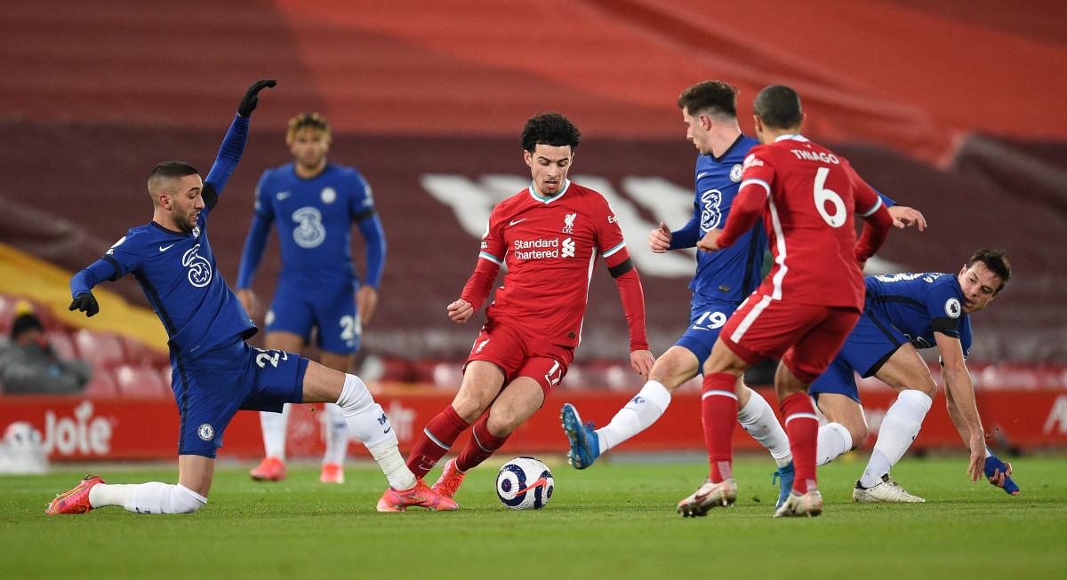 Curtis Jones dribbles past Chelsea's Hakim Ziyech and Mason Mount