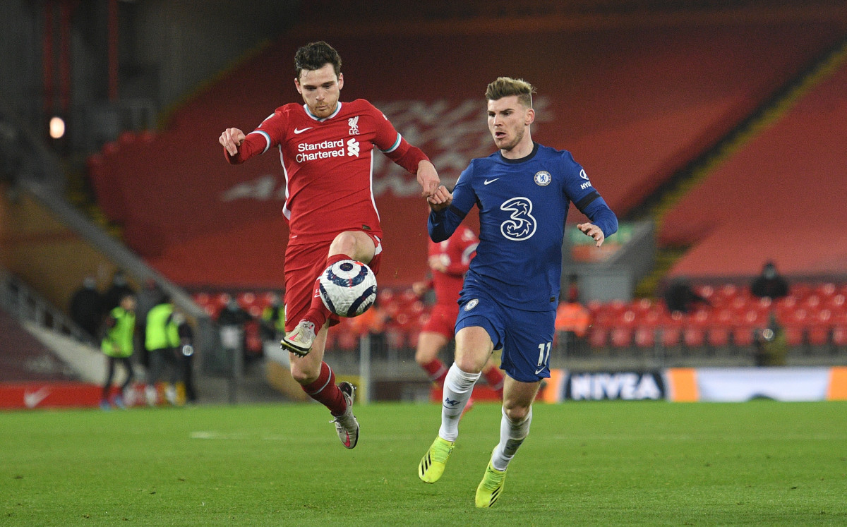 Andy Robertson and Timo Werner challenge for the ball