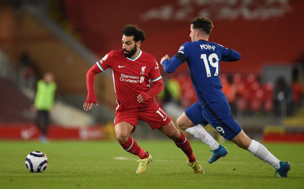 Mo Salah looks to drive away from match winner Mason Mount