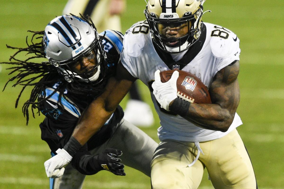 Jan 3, 2021; Charlotte, North Carolina, USA; Saints running back Ty Montgomery (88) with the ball as Carolina cornerback Donte Jackson (26). Mandatory Credit: Bob Donnan-USA TODAY Sports
