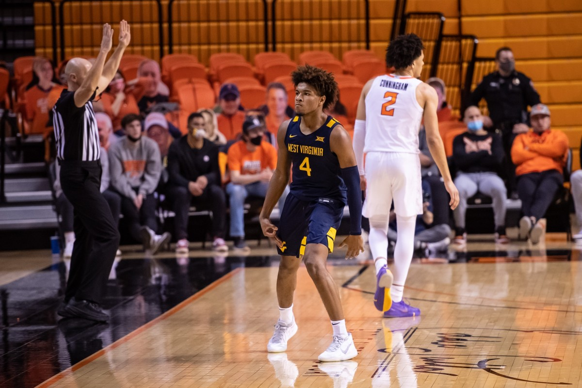 Jan 4, 2021; Stillwater, Oklahoma, USA; West Virginia Mountaineers guard Miles McBride (4) reacts after scoring a three point basket against the Oklahoma State Cowboys during the second half at Gallagher-Iba Arena.