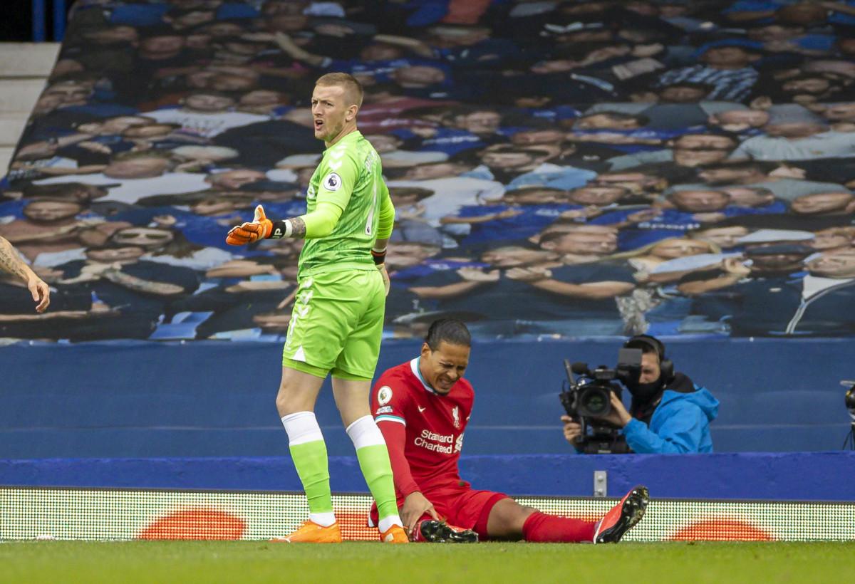 Virgil van Dijk down injured in the fixture against Everton