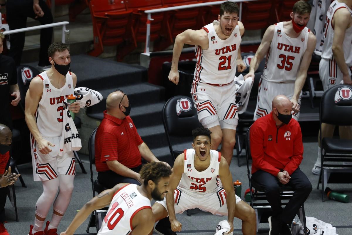 Mar 6, 2021; Salt Lake City, Utah, USA; Utah Utes guard Alfonso Plummer (25) along with the rest if the bench react to a play by guard Jordan Kellier (10) in the second half against the Arizona State Sun Devils at Jon M. Huntsman Center.