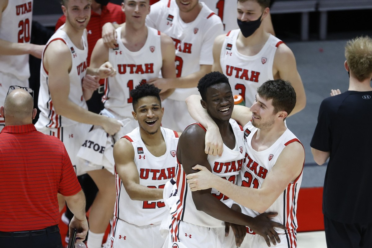 Mar 6, 2021; Salt Lake City, Utah, USA; Utah Utes center Lahat Thioune (32) is congratulated by forward Riley Battin (21) after playing in the second half against the Arizona State Sun Devils at Jon M. Huntsman Center.