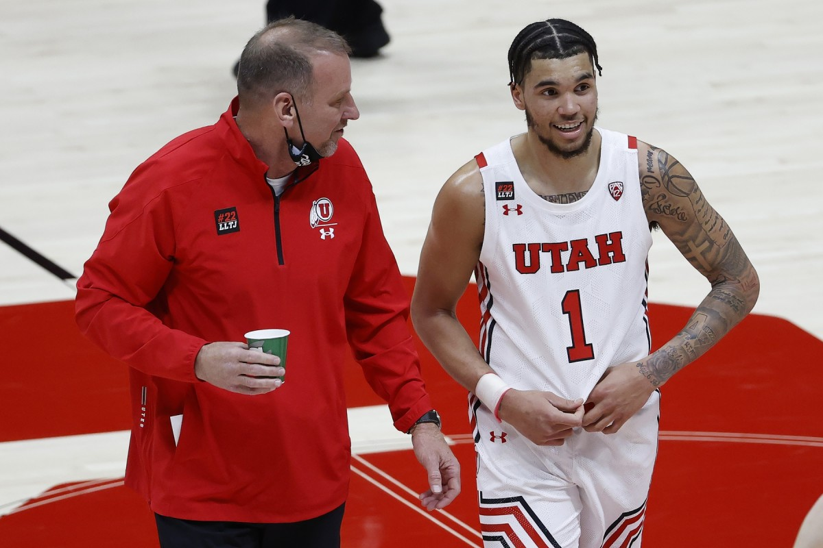 Mar 6, 2021; Salt Lake City, Utah, USA; Utah Utes head coach Larry Krystkowiak and forward Timmy Allen (1) react on the way to the locker room at halftime against the Arizona State Sun Devils at Jon M. Huntsman Center.