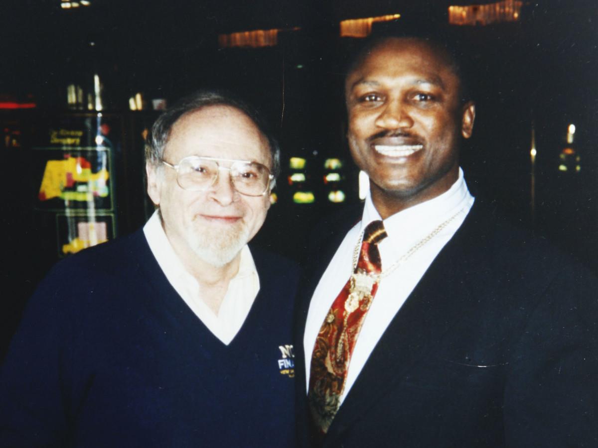 Jerry Izenburg poses with Joe Frazier.