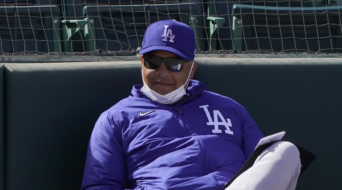 Dave Roberts watches a spring training game