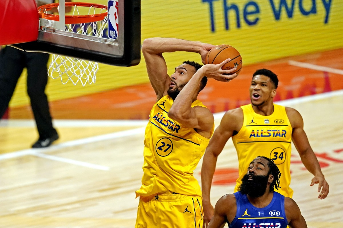 Rudy Gobert (27) dunks over James Harden (blue) during the 2021 ASG
