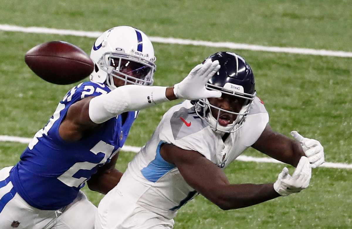 Indianapolis Colts cornerback Xavier Rhodes (27) blocks a pass to Tennessee Titans wide receiver A.J. Brown (11) at Lucas Oil Stadium in Indianapolis, Sunday, Nov. 29, 2020. Tennessee Titans defeated the Indianapolis Colts, 45-26. Ini 1129 Colts Vs Titans