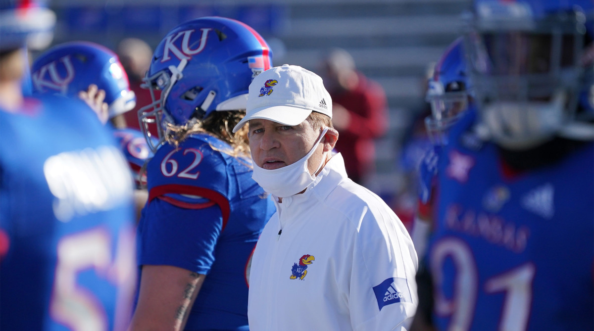 Oct 31, 2020; Lawrence, Kansas, USA; Kansas Jayhawks head coach Les Miles watches team warm ups before the game against the Iowa State Cyclones at David Booth Kansas Memorial Stadium.