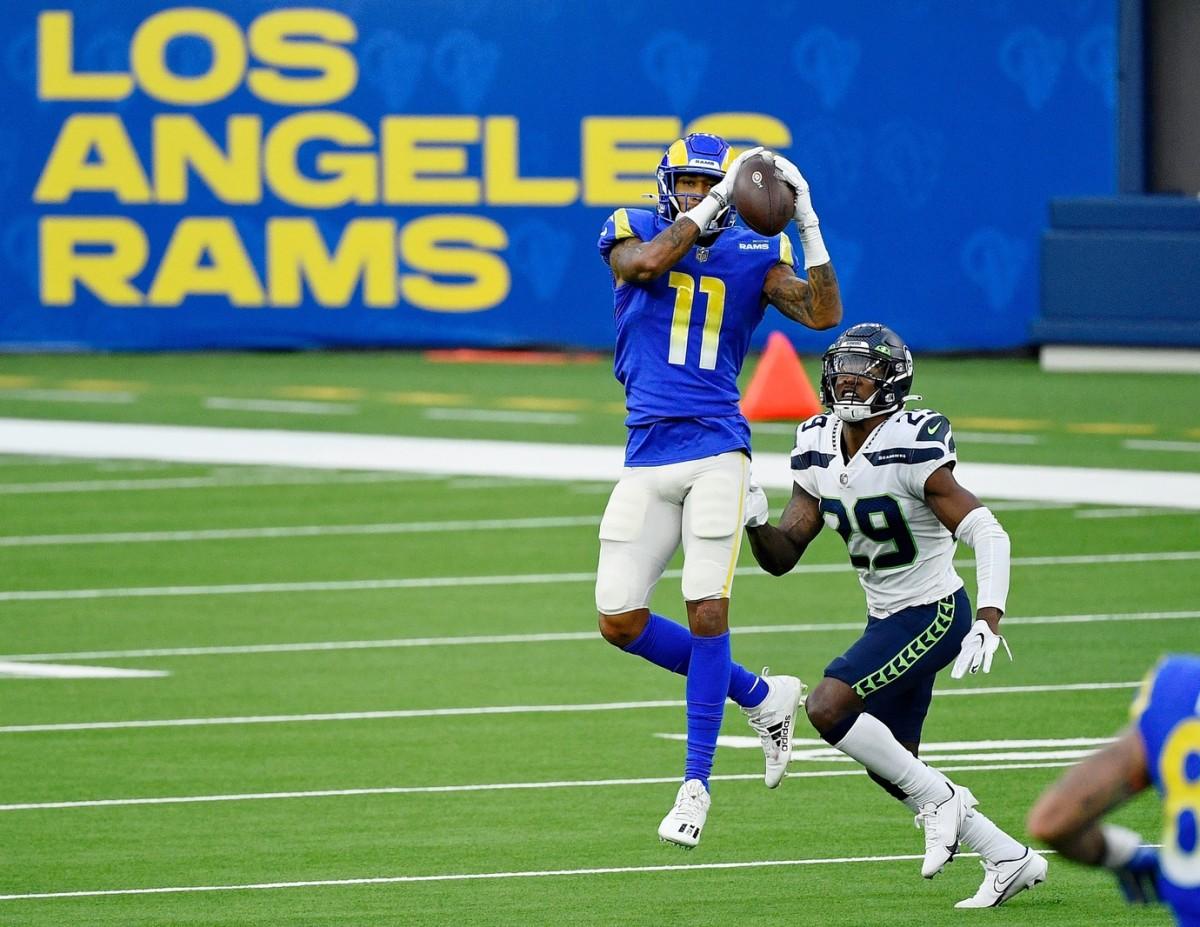 Nov 15, 2020; Inglewood, California, USA; Rams wide receiver Josh Reynolds (11) makes a catch in front of Seahawks defensive back Jayson Stanley (29). Mandatory Credit: Robert Hanashiro-USA TODAY Sports