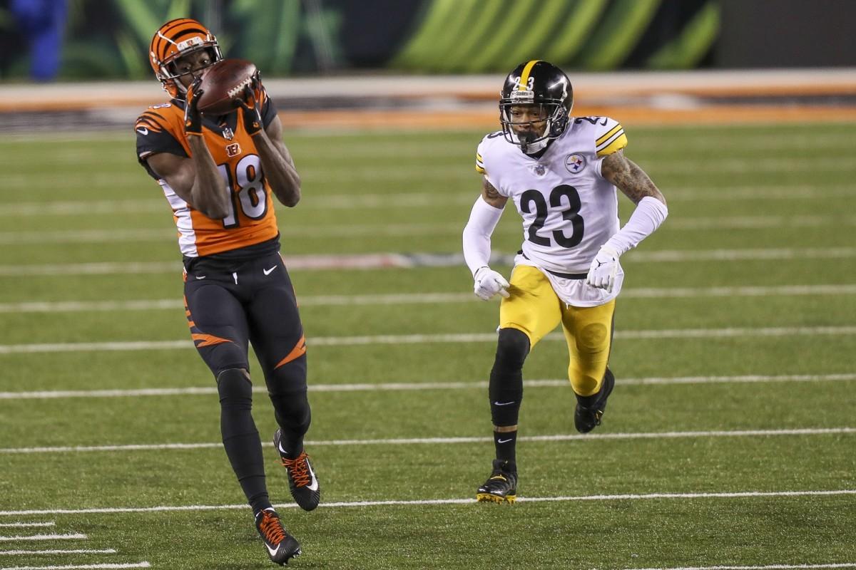 Dec 21, 2020; Cincinnati, Ohio, USA; Bengals wide receiver A.J. Green (18) catches a pass against Steelers cornerback Joe Haden (23). Mandatory Credit: Katie Stratman-USA TODAY