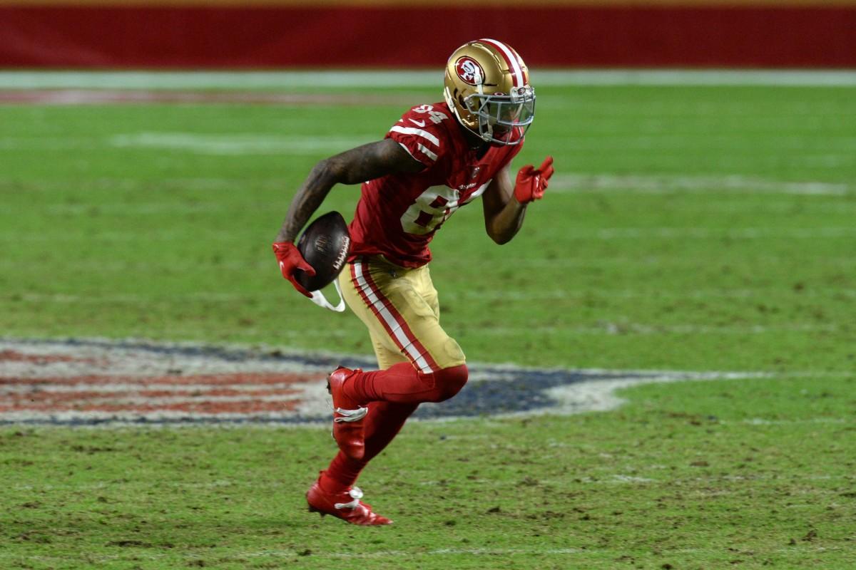 Dec 13, 2020; Glendale, Arizona, USA; 49ers wide receiver Kendrick Bourne (84) runs with the ball against Washington. Mandatory Credit: Joe Camporeale-USA TODAY