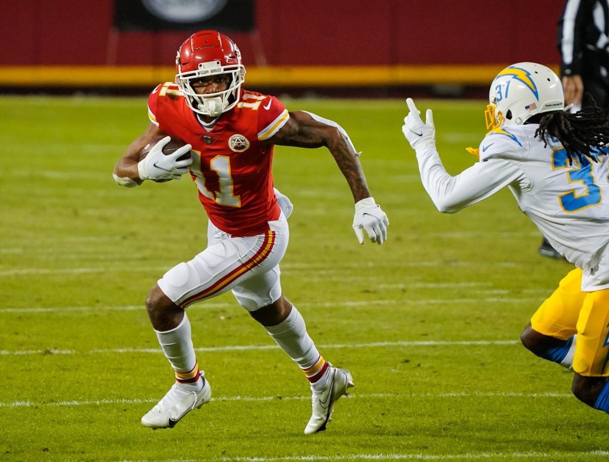 Jan 3, 2021; Kansas City, Missouri, USA; Chiefs wide receiver Demarcus Robinson (11) runs the ball against Chargers cornerback Tevaughn Campbell (37). Mandatory Credit: Jay Biggerstaff-USA TODAY