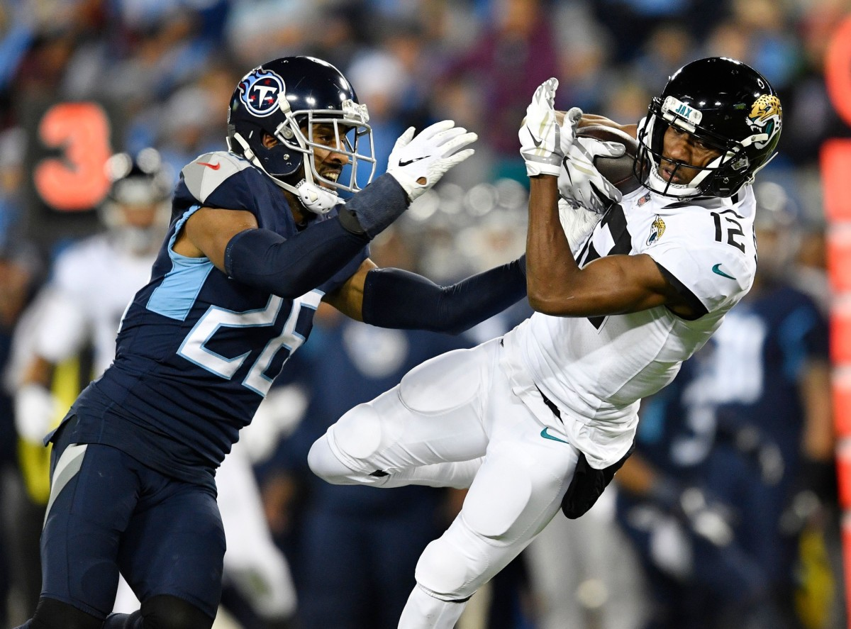 Jaguars wide receiver Dede Westbrook (12) makes a catch defended by Titans cornerback Logan Ryan (26)© Andrew Nelles / Tennessean.com