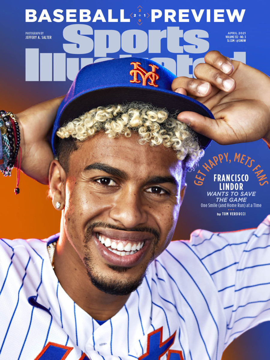 Francisco Lindor poses with his new Mets hat