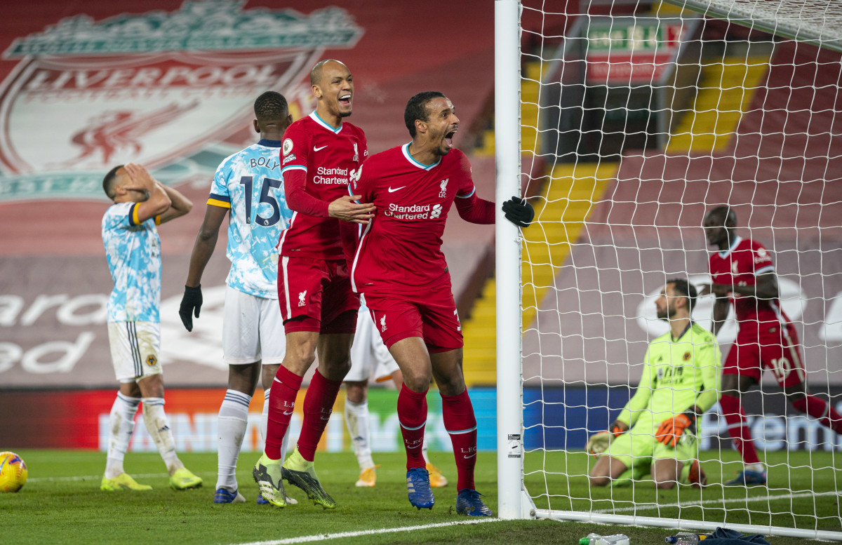 Joel Matip celebrates after scoring Liverpool's 3rd goal against Wolves.