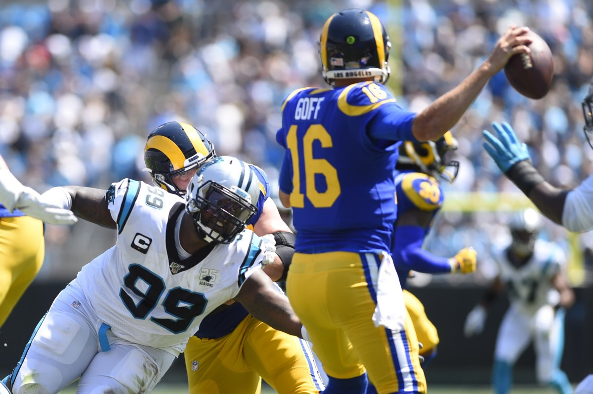 Sep 8, 2019; Charlotte, NC, USA; Rams quarterback Jared Goff (16) looks to pass as Carolina defensive tackle Kawann Short (99) pressures. Mandatory Credit: Bob Donnan-USA TODAY