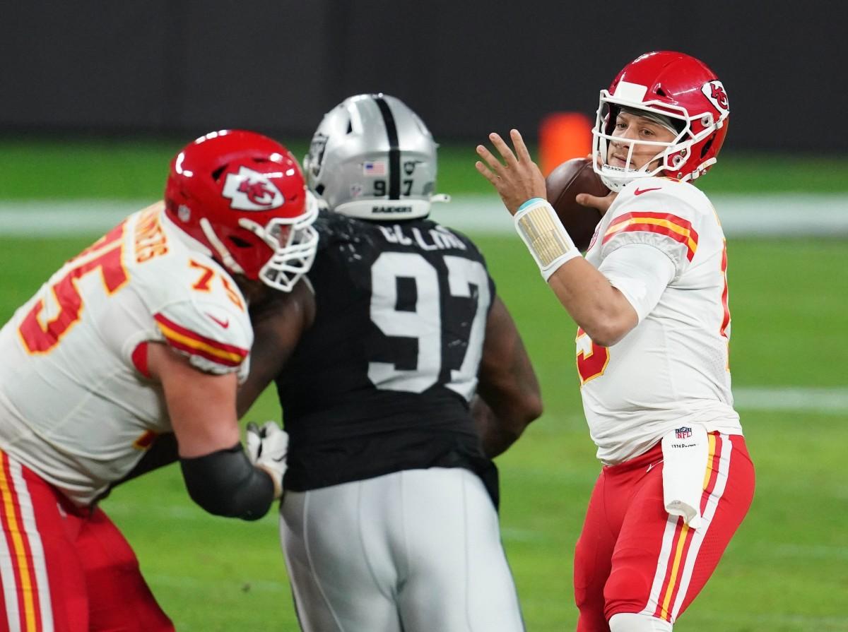 Nov 22, 2020; Paradise, Nevada, USA; Chiefs quarterback Patrick Mahomes (15) throws against Raiders defensive tackle Maliek Collins (97). Mandatory Credit: Kirby Lee-USA TODAY