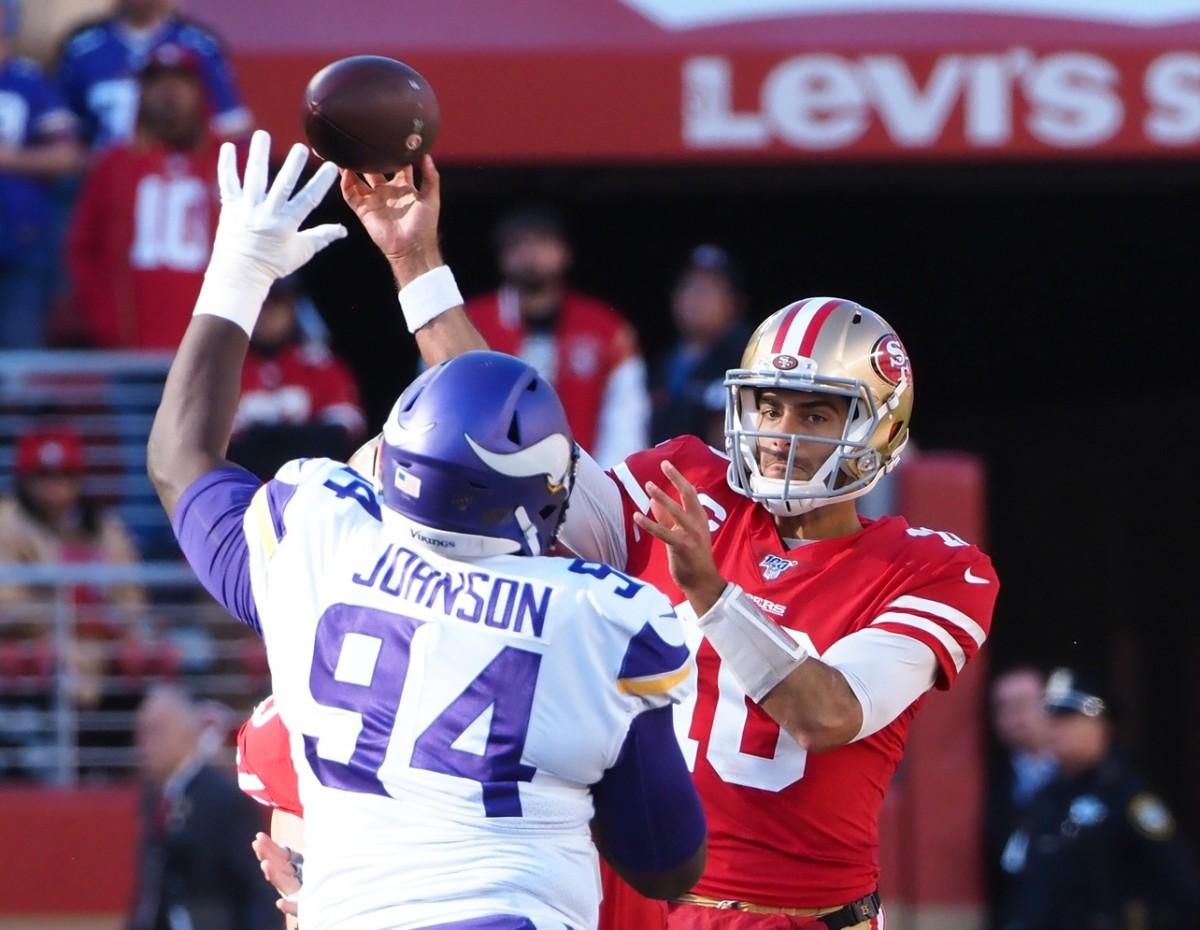 Jan 11, 2020; Santa Clara, California, USA; 49ers quarterback Jimmy Garoppolo (10) throws under pressure from Minnesota defensive tackle Jaleel Johnson (94). Mandatory Credit: Kelley L Cox-USA TODAY Sports