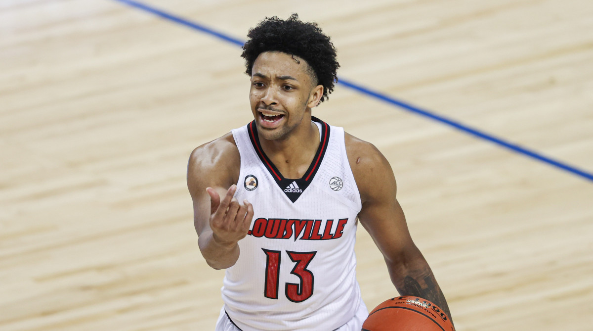 Louisville Cardinals guard David Johnson (13) directs his team against the Duke Blue Devils in the second round of the 2021 ACC tournament at Greensboro Coliseum.