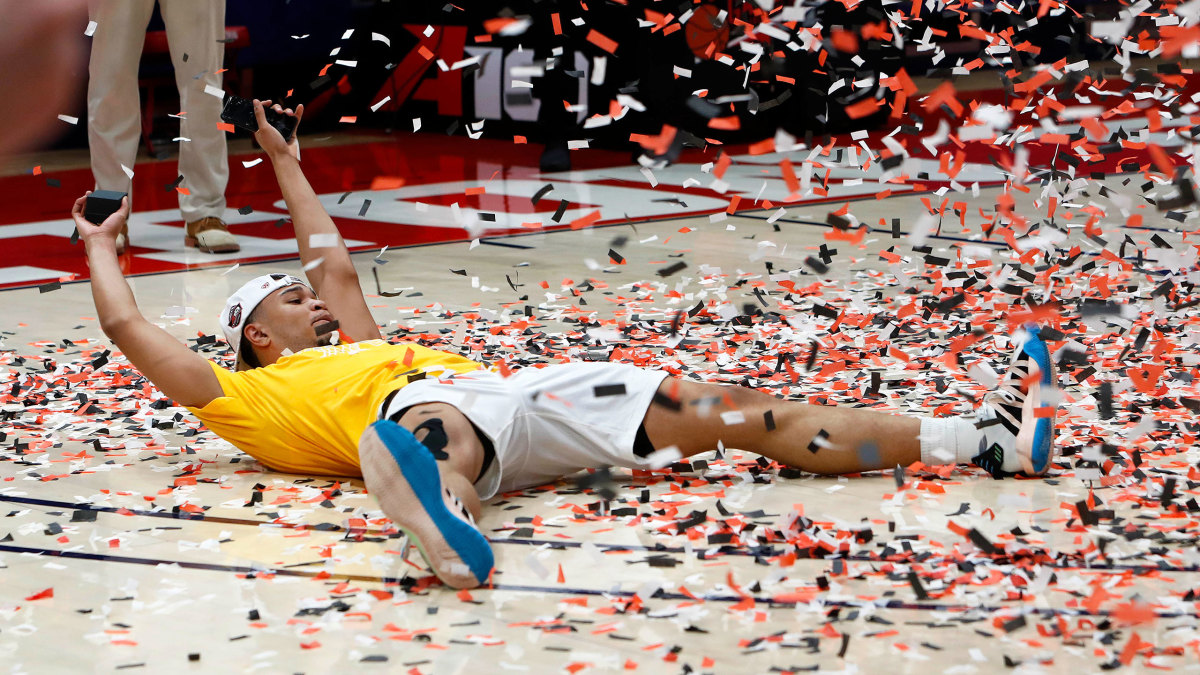 St. Bonaventure's Jaren Holmes soaks in the confetti after an A-10 championship win