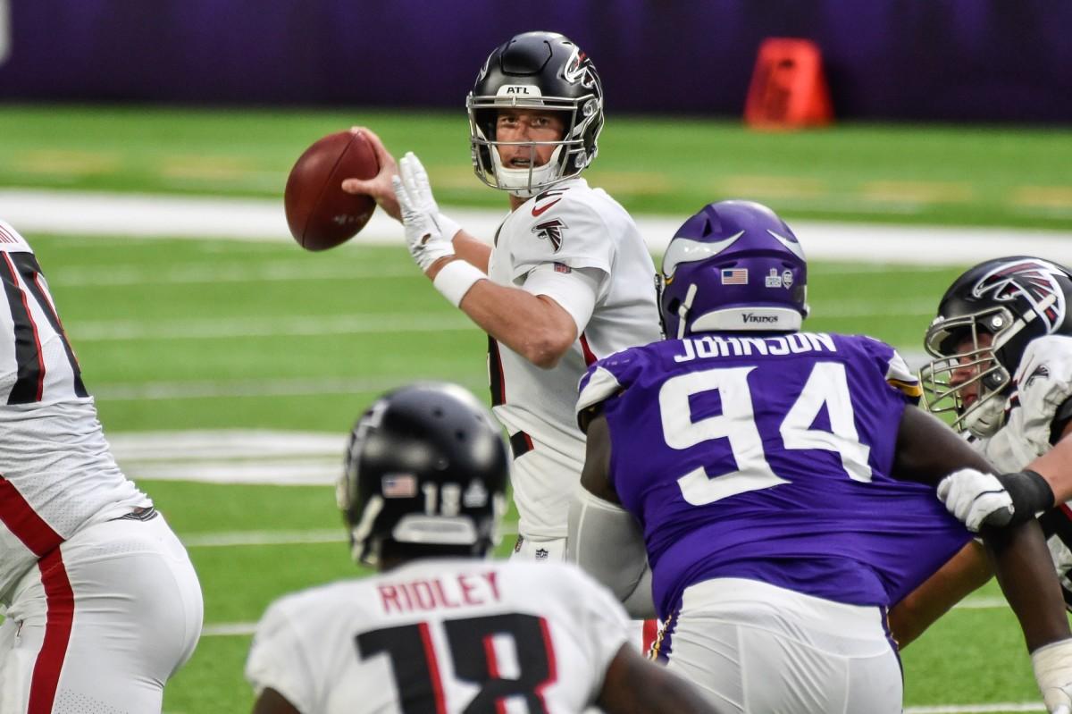 Oct 18, 2020; Minneapolis, Minnesota, USA; Atlanta quarterback Matt Ryan (2) throws a pass as Vikings defensive tackle Jaleel Johnson (94). Mandatory Credit: Jeffrey Becker-USA TODAY