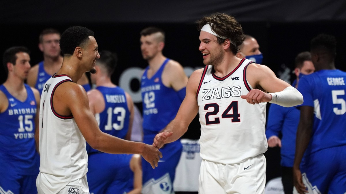 Jalen Suggs and Corey Kispert celebrate during the WCC tournament championship game.