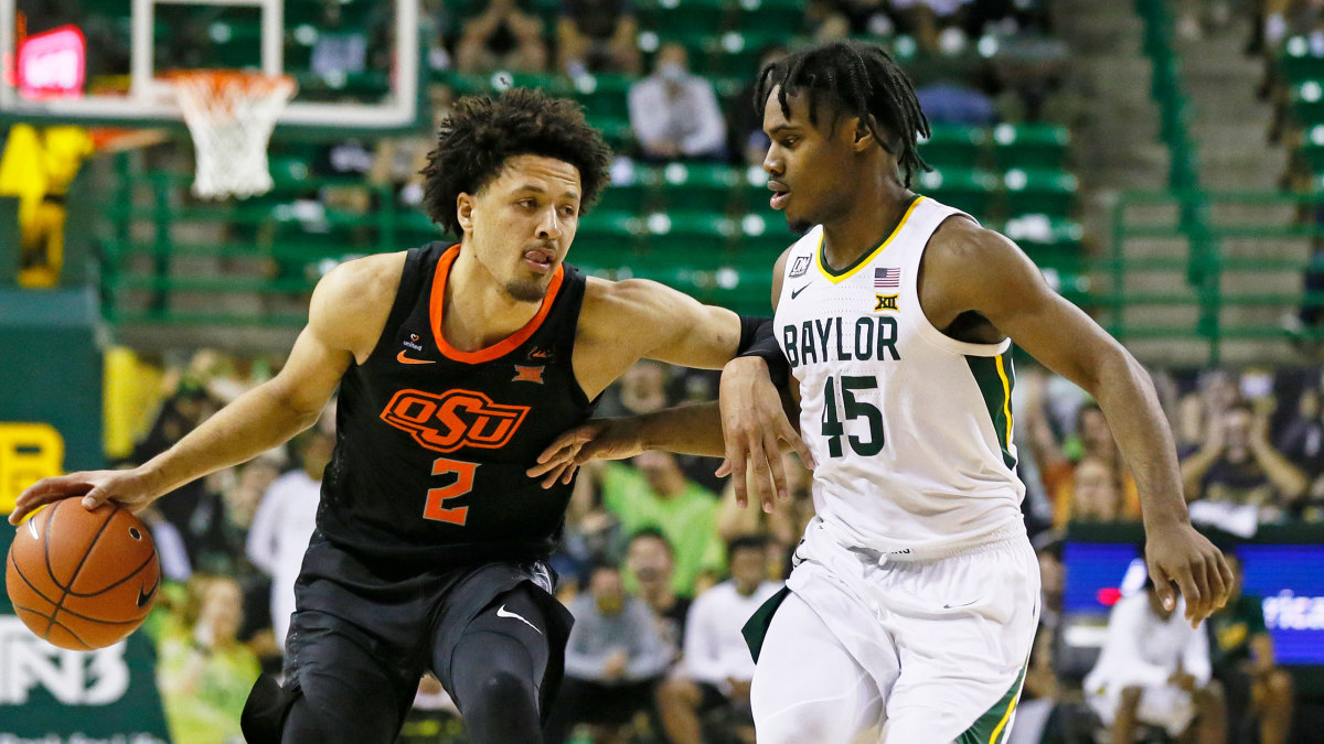 Oklahoma State's Cade Cunningham dribbles vs. Baylor