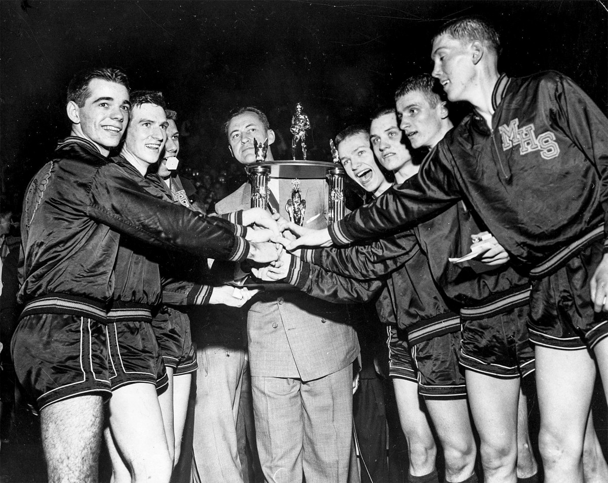 Bobby Plump (second from right) and Milan High School celebrate their 1954 championship