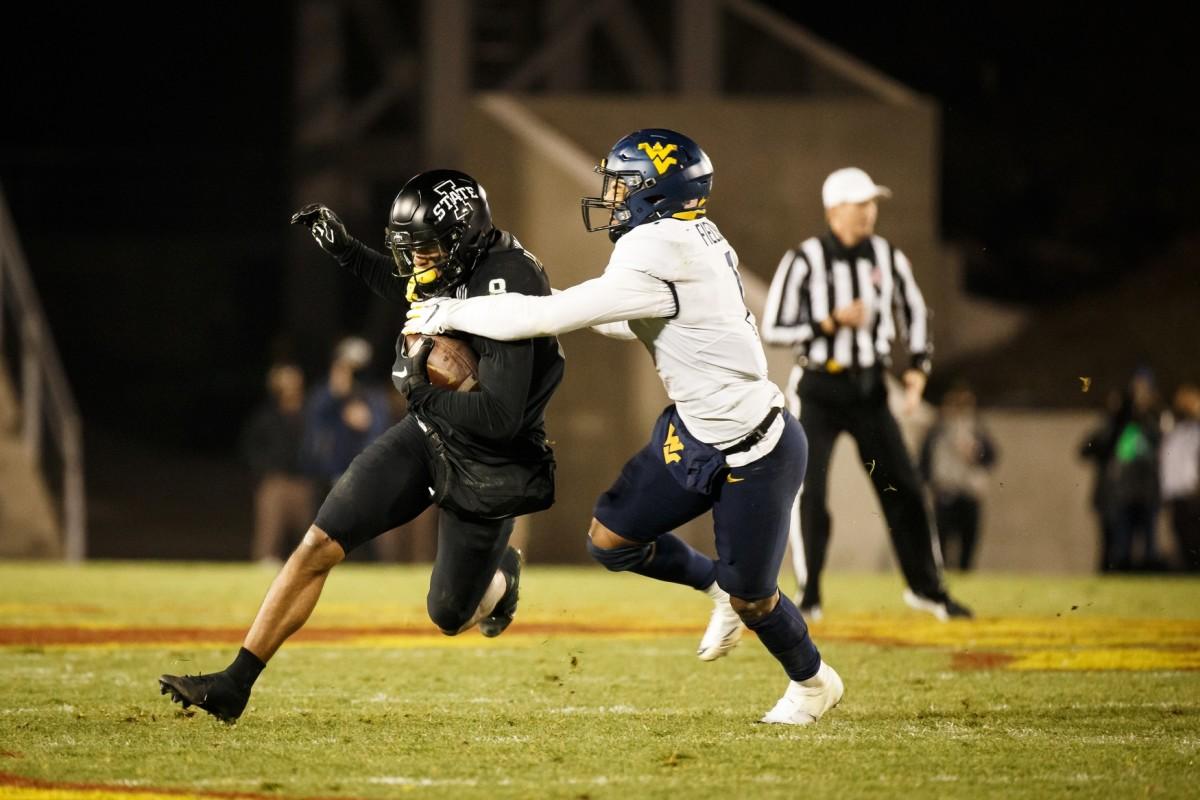 Dec 5, 2020; Ames, Iowa, USA; Iowa State receiver Xavier Hutchinson (8) tries to get around West Virginia linebacker Tony Fields II (1). Mandatory Credit: Brian Powers-USA TODAY