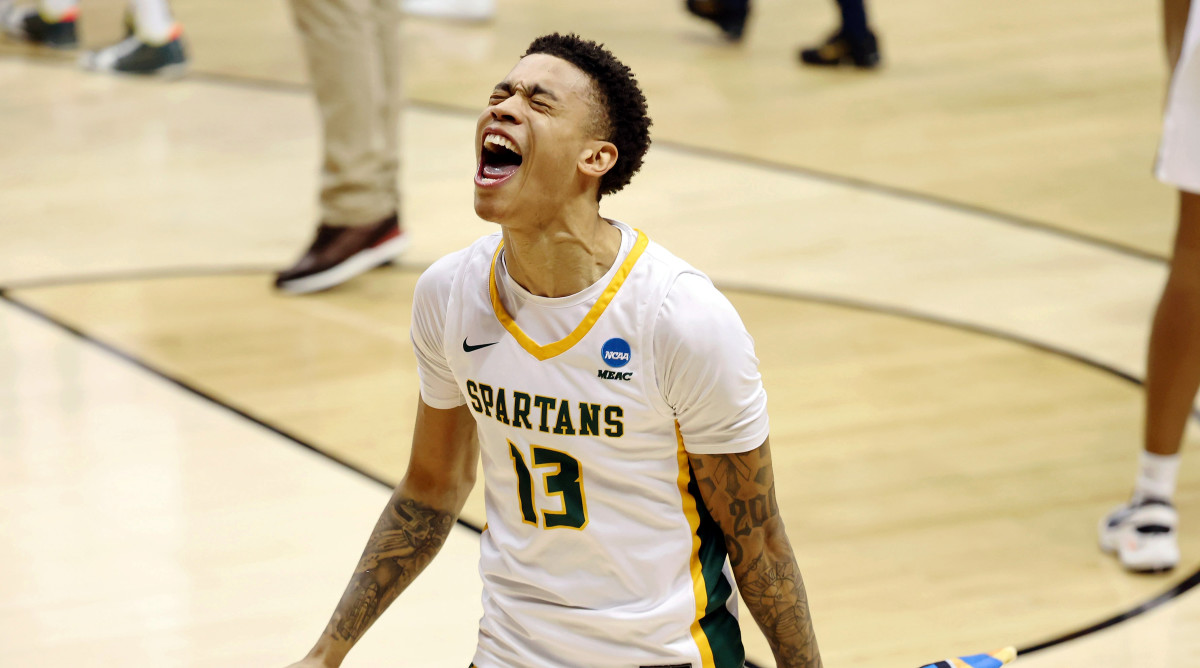 Mar 18, 2021; Bloomington, Indiana, USA; Norfolk State Spartans guard Daryl Anderson (13) celebrates their win over the Appalachian State Mountaineers in the First Four of the 2021 NCAA Tournament at Simon Skjodt Assembly Hall. The Norfolk State Spartans won 54-53.