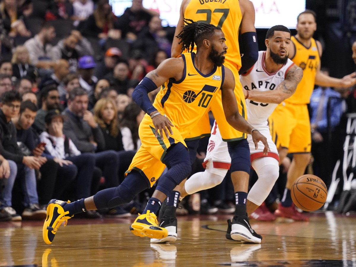Mike Conley (10) leads the Jazz down the floor against the Toronto Raptors