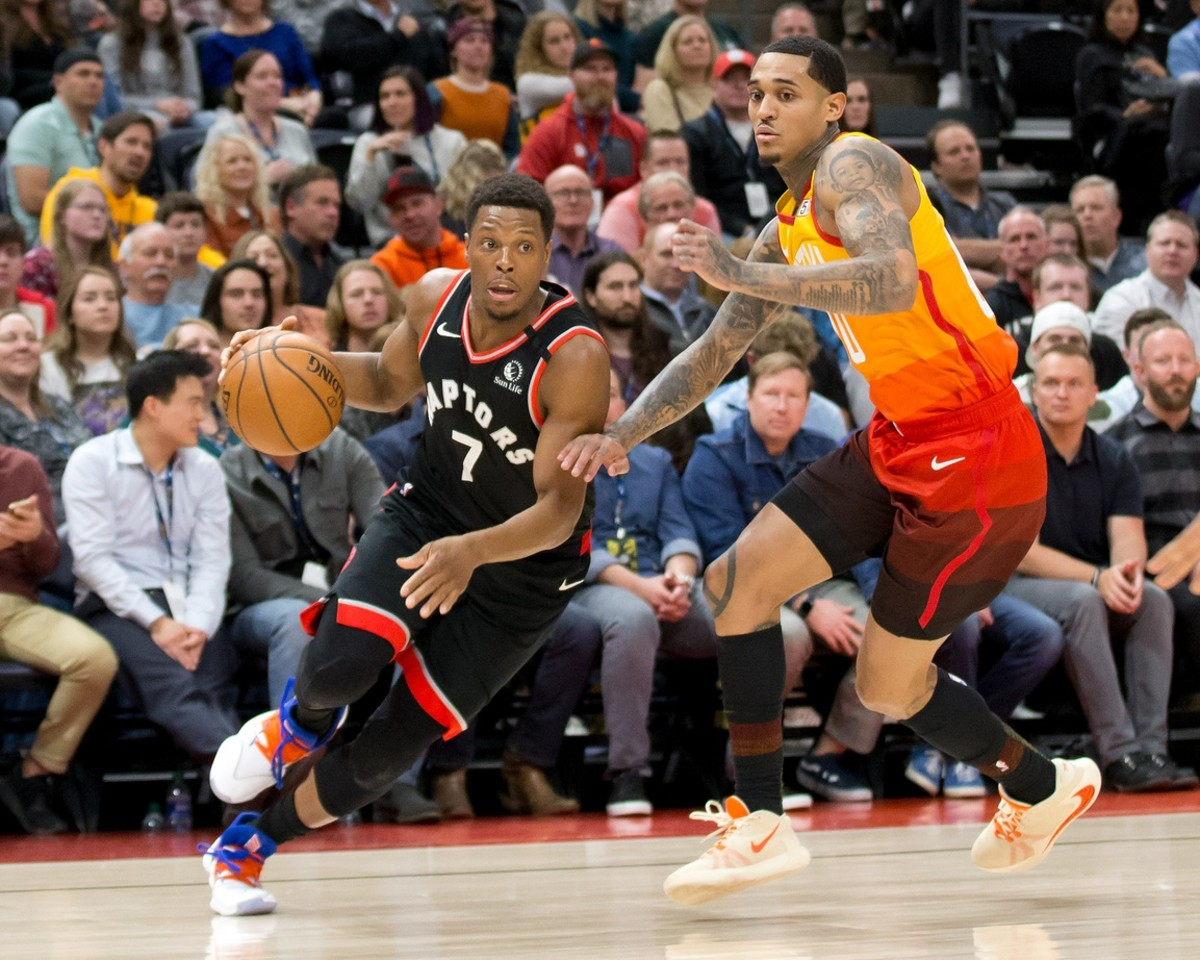 Jordan Clarkson (00) takes on Kyle Lowry (7) in a matchup between the Jazz and Raptors