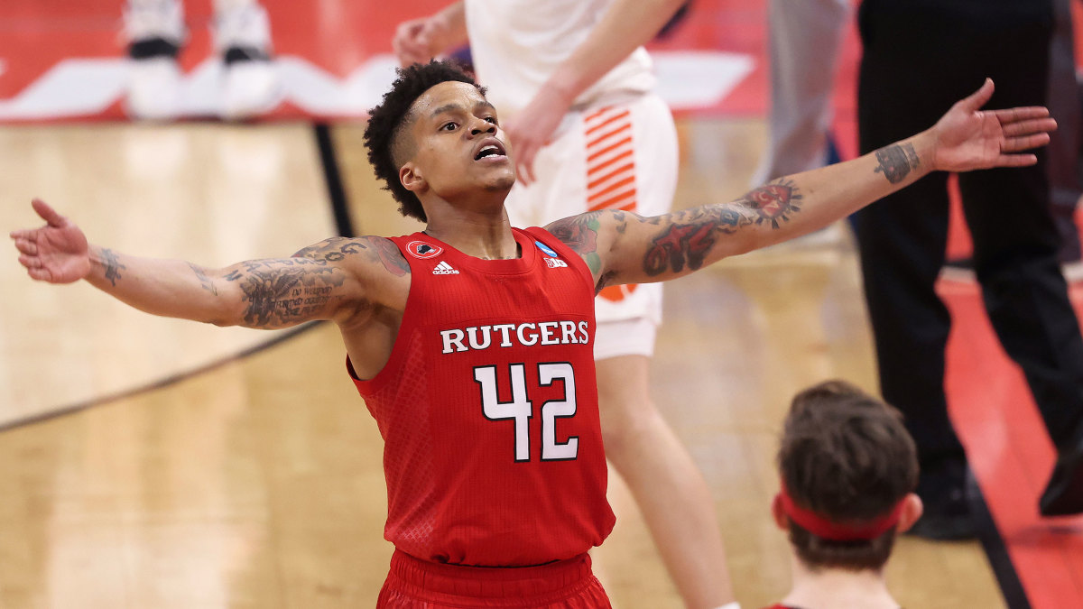 Rutgers guard Jacob Young holds out his arms during a win over Clemson