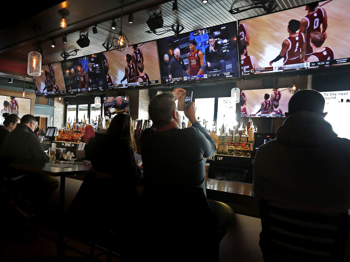 Patrons take in the tournament from a bar in Indy