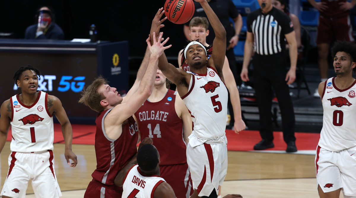 Arkansas Razorbacks guard Moses Moody (5) and Colgate Raiders guard Tucker Richardson (15) battle for a rebound during the second half in the first round of the 2021 NCAA Tournament