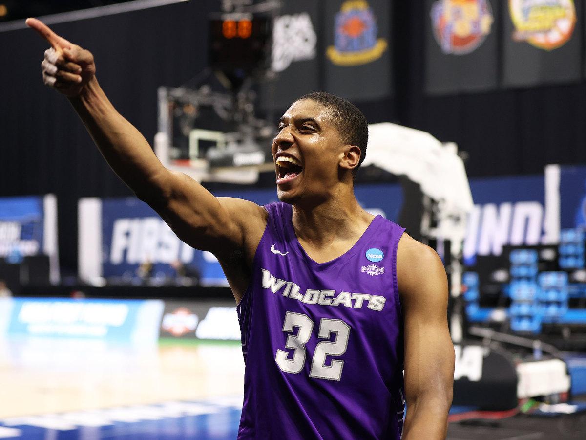 Abilene Christian's Joe Pleasant celebrates the Wildcats' shocking win over Texas
