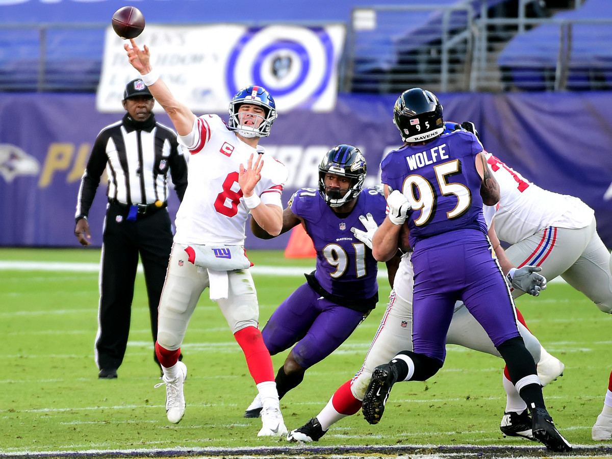 Dec 27, 2020; Baltimore, Maryland, USA; New York Giants quarterback Daniel Jones (8) throws a pass in the third quarter against the Baltimore Ravens at M&T Bank Stadium.