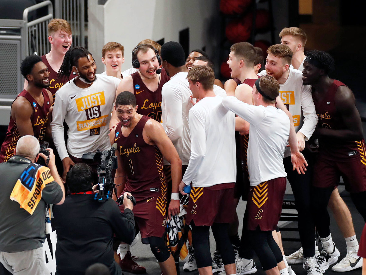 Loyola Chicago swarms Cameron Krutwig during an interview