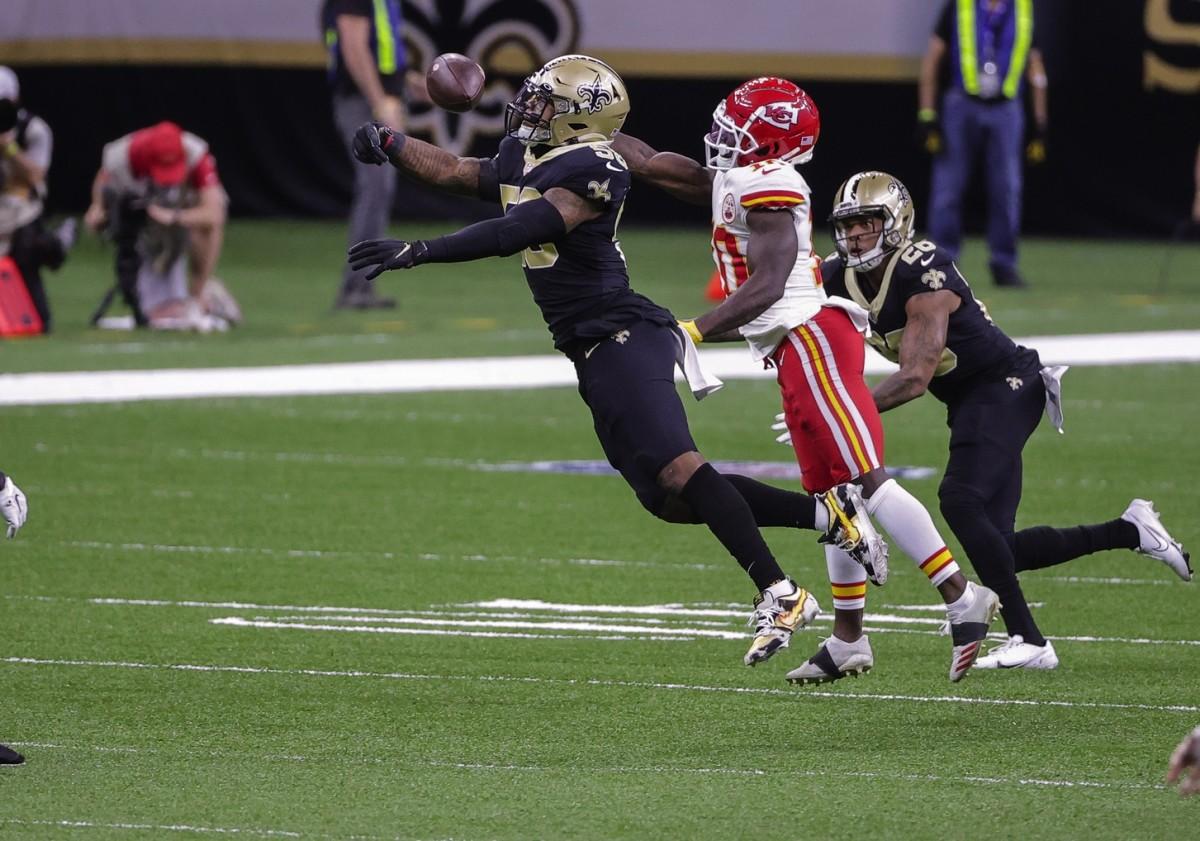 Dec 20, 2020; New Orleans, Louisiana, USA; Saints linebacker Kwon Alexander (58) breaks up a pass to Chiefs wide receiver Tyreek Hill (10). Mandatory Credit: Derick E. Hingle-USA TODAY