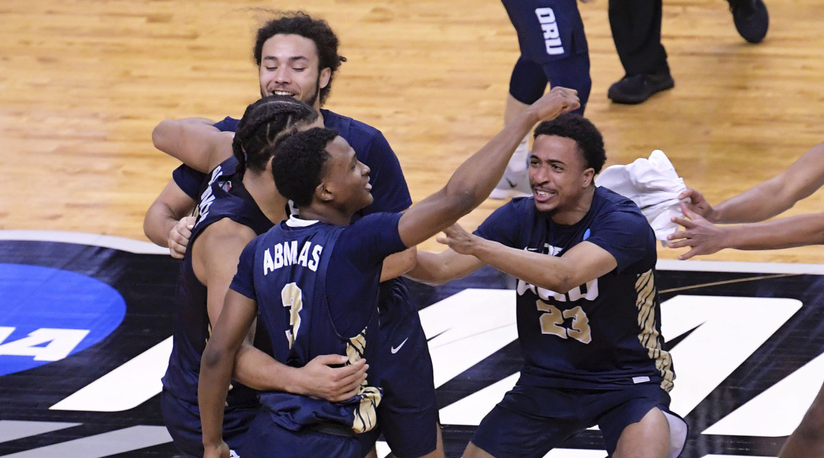 Oral Roberts Golden Eagles celebrate their 81-78 victory over the Florida Gators during the second round of the 2021 NCAA Tournament on Sunday, March 21, 2021,