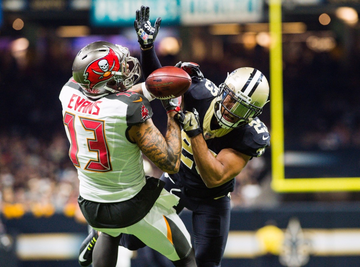 Saints cornerback Marshon Lattimore breaks up a pass thrown to Tampa Bay wide receiver Mike Evans. Mandatory Credit: Scott Clause/The Daily Advertiser via USA TODAY NETWORK