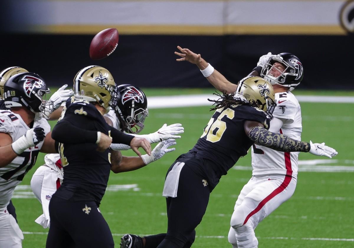 Nov 22, 2020; New Orleans, Louisiana, USA; Saints linebacker Demario Davis (56) hits Atlanta quarterback Matt Ryan (2) forcing an incomplete pass. Mandatory Credit: Derick E. Hingle-USA TODAY