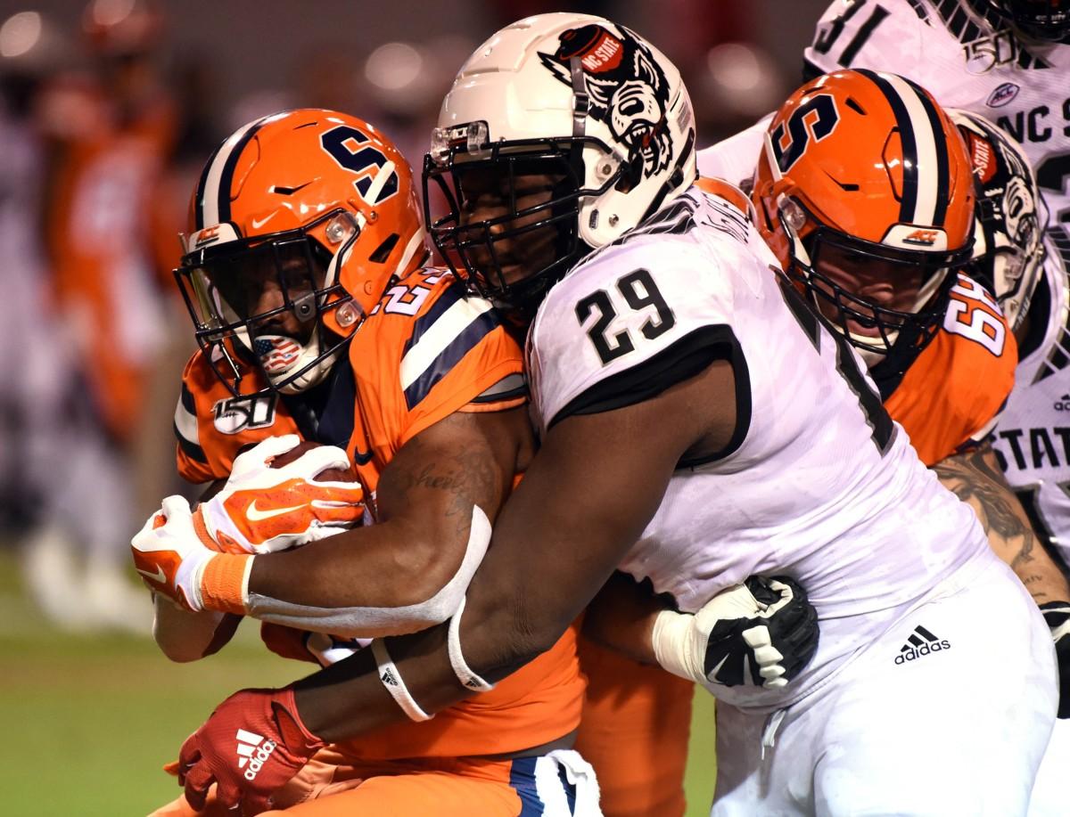 Oct 10, 2019; Raleigh, NC, USA; Syracuse running back Abdul Adams (23) is tackled by North Carolina State defensive tackle Alim McNeill (29). Mandatory Credit: Rob Kinnan-USA TODAY Sports