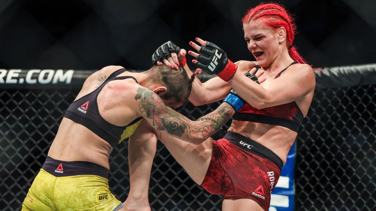 Gillian Robertson delivers a knee strike to her opponent during a UFC match