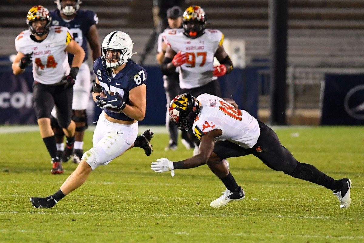 Nov 7, 2020; University Park, Pennsylvania, USA; Penn State tight end Pat Freiermuth (87) runs with the ball after a catch as Maryland defensive back Jordan Mosley (18) defends. Mandatory Credit: Rich Barnes-USA TODAY Sports