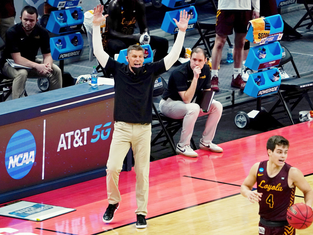 Mar 21, 2021; Indianapolis, Indiana, USA; Loyola Ramblers head coach Porter Moser reacts as guard Braden Norris (4) dribbles the ball against the Illinois Fighting Illini during the first half in the second round of the 2021 NCAA Tournament at Bankers Life Fieldhouse.